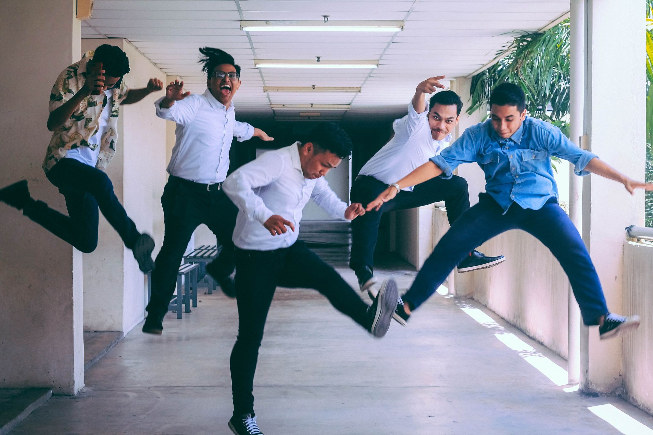 young business men jumping into the air in excitement