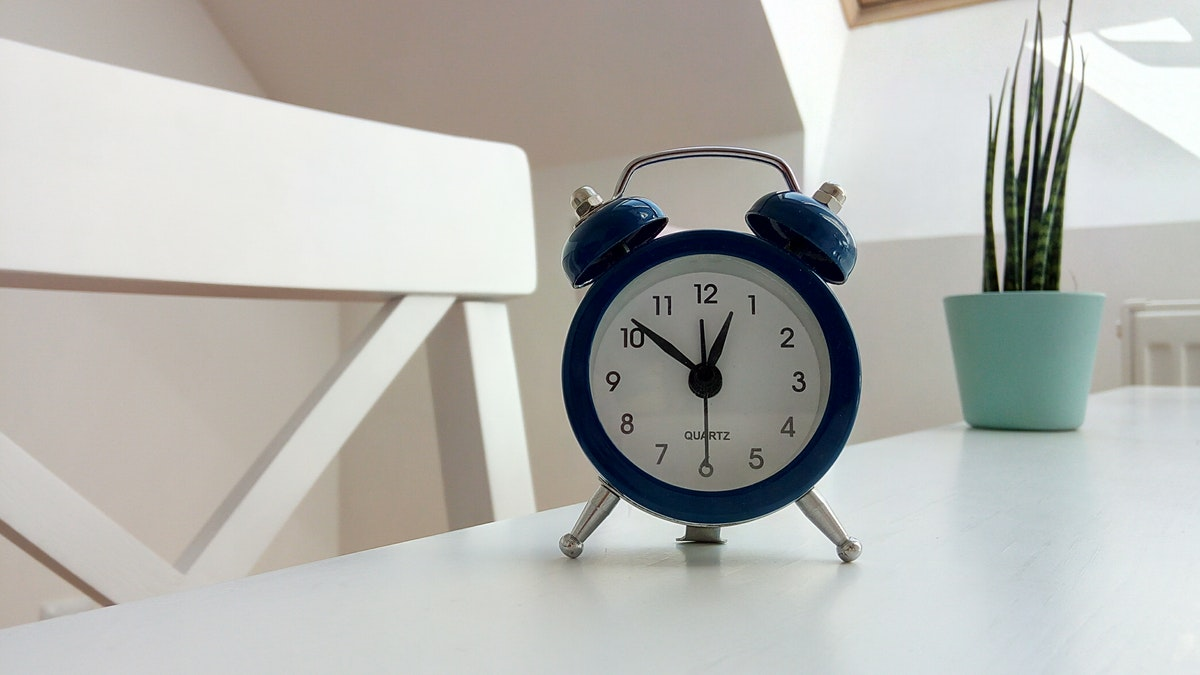clock on desk representing time management